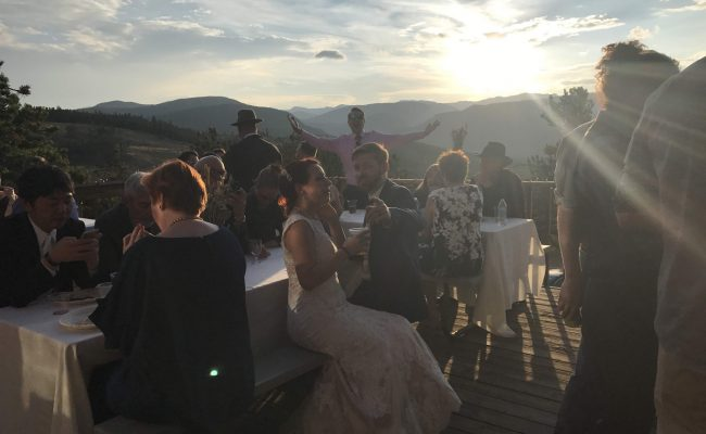 Wedding and view of sunset over mountains